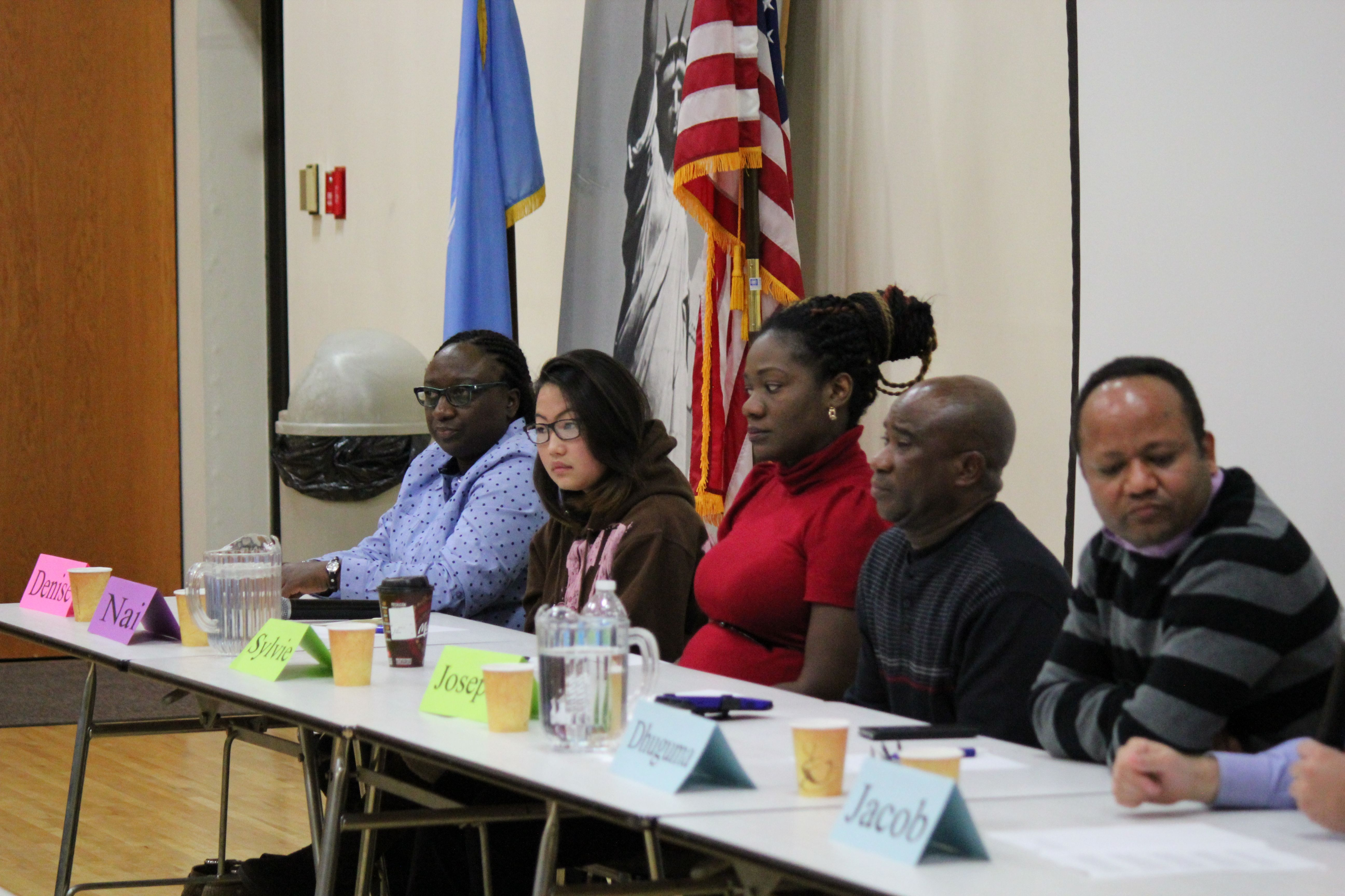 Five New Americans Speaking on a pannel