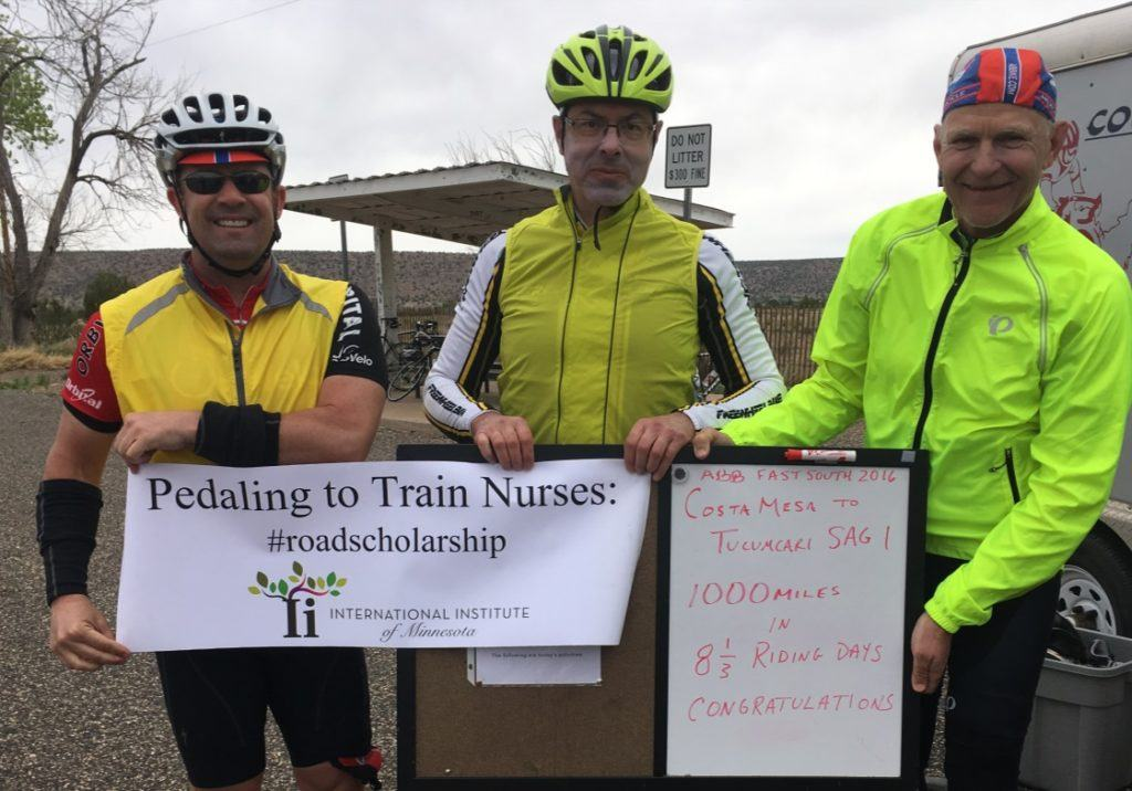 "Jeff and two bikers hold sign reading ""pedaling to train nurses"""