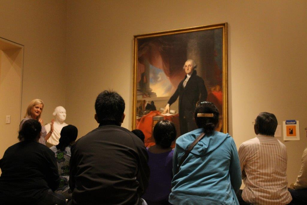 New Citizens in front of George Washington's portrait