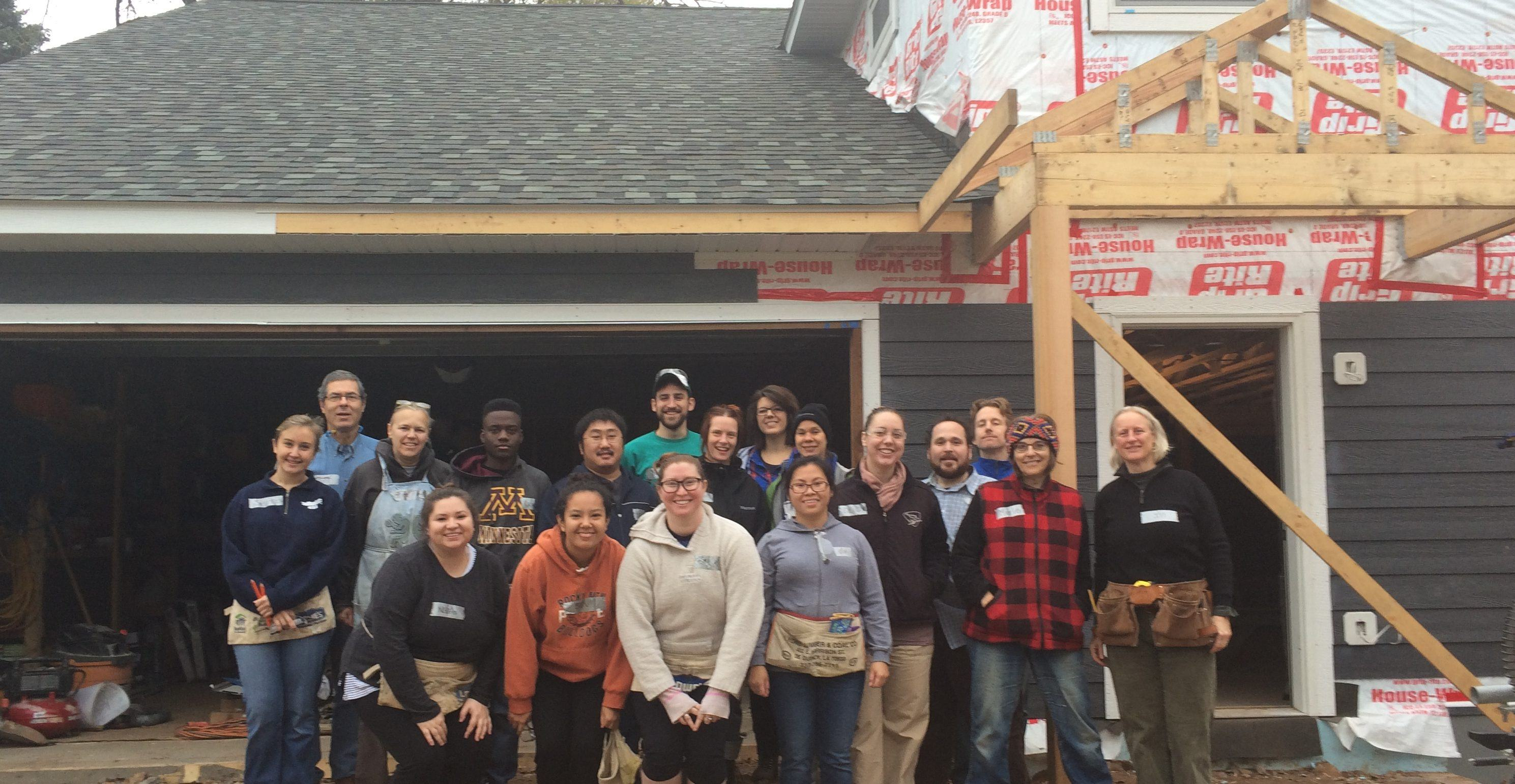 Staff in front of Habitat home