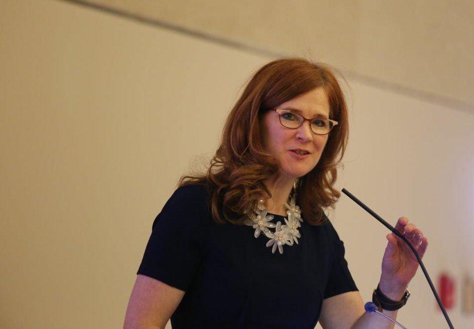 Executive Director Jane Graupman speaking at podium