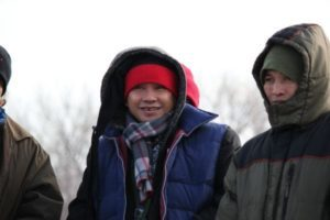 Two Karen refugees dressed in winter gear smiling