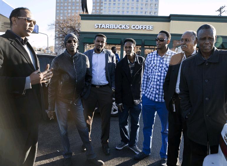 Somali Men Outside of a Starbucks