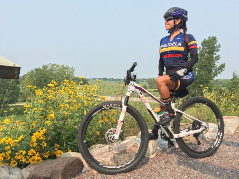 Yosmary Mejias standing with her bike outdoors