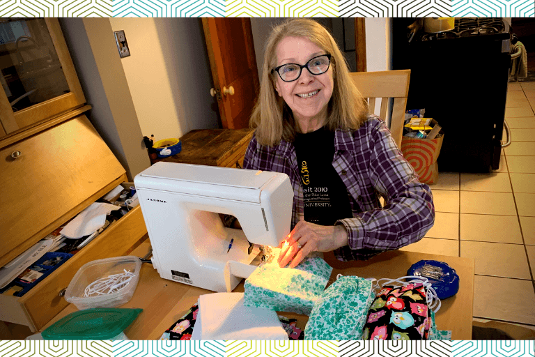 Institute volunteer Mary Barton sews masks