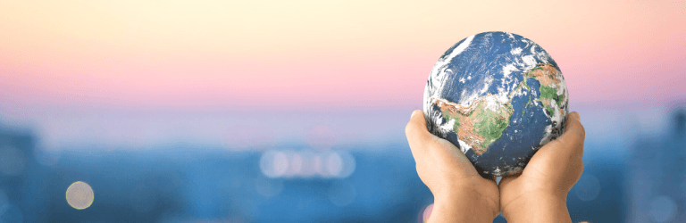 Give to the International Institute of Minnesota - picture of hands holding globe