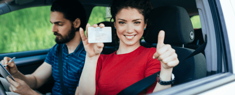 Woman shows new driver's license in car