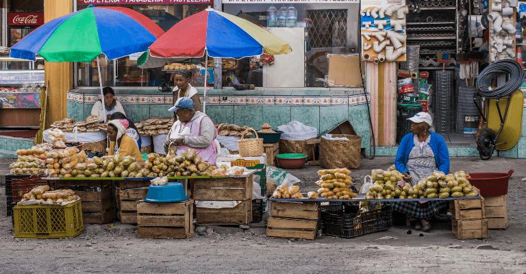 Women working at market in Ecuador - International Women's Day